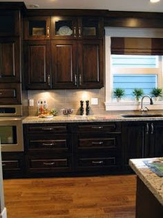 Dark cabinets, light granite, neutral backsplash