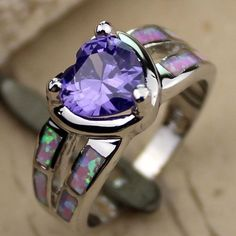 Amethyst and Pink Fire Opal!!!Love the combination. Plus, the amethyst is my Birthstone!!