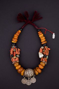 Morocco | Early 1900s Berber necklace.  Amber, coral, shells, glass beads, silver and enamel.