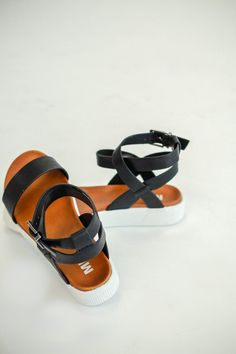 29ab7d29b94 Fall in love with these perfect summer sandals! Interlocking ankle straps  an adjustable buckle closure