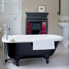 Roll top bath with an original cast iron fireplace. // Note from Jacob below. // I like the look of the bathtub. Not color-wise per say, but more so the thought of having a Victorian roll top with claw feet. Victorian Interiors, Modern Victorian, Vintage Interiors, Victorian Homes, Black Bathtub, Black Tub, Bathroom Black, Classic Bathroom Inspiration, Bathroom Fireplace