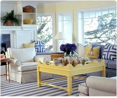 coastal living yellow coffee table. I've always loved the blue and yellow color combo