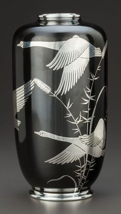 A ROSENTHAL PORCELAIN AND SILVER OVERLAY VASE.