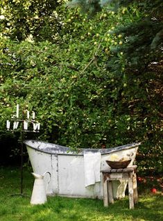 outdoor bath...Do you remember Papa filling the old clawfoot tub outside with warm water so you kids could play in it?