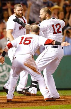 BOSTON, MA - JULY 22: Mike Napoli #12 is congratulated by Dustin Pedroia #15 of the Boston Red Sox at home plate after hitting a walk-off home run in the 11th inning against the New York Yankees during the game on July 22, 2013 at Fenway Park in Boston, Massachusetts. (Photo by Jared Wickerham/Getty Images)