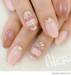 Nude and pink glitter nail art with details