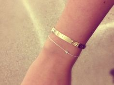 Cartier love bangle and barely there diamond-stud bracelet. I'll take that combo