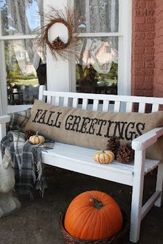 LOVE this front porch. I have the perfect filler for that cushion. I just don't have a bench   Crafting Rebellion: Burlap Web Finds