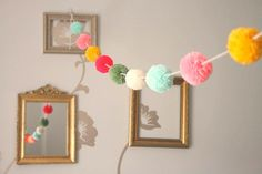 pom poms garland. might use this for christmas tree decorations