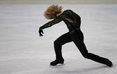 Russia's Artem Borodulin performs in the men's 2010 Winter Olympics figure skating free program at the Pacific Coliseum in Vancouver, on February 18, 2010. (VINCENZO PINTO/AFP/Getty Images)