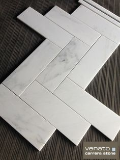 """$8.00 a square foot Carrara Venato 4x12"""" Honed marble tile.  Install on the wall in a brick format or as we have attempted to show in our warehouse shot here a Herringbone format on the floor. #4x12 #carrara #tile"""
