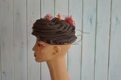 Mariana fashions vintage hats from marine litter. Follow her on Twitter @TheOceanCorner.