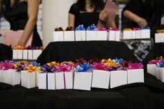 "At the silent auction, guests could buy ""mystery boxes."" If the number on the bottom of the box matched the..."