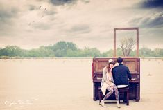 Engagement photos done in a field with a piano. Simply breathtaking.