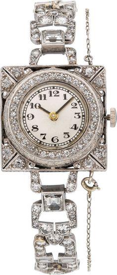 Art Deco Swiss Lady's Diamond, Platinum Wristwatch Case: 20 mm x 20 mm, pierced platinum having European-cut diamond accents, bezel framed by single-cut diamonds Dial: silvered with black Arabic numerals, black baton hand hour and minute hands, mineral crystal Movement: unadjusted 6 jewel quartz
