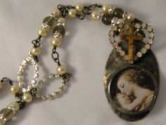 Madonna and Child Religious Necklace Vintage Rhinestone Heart and Cross Necklace. $52.00, via Etsy.