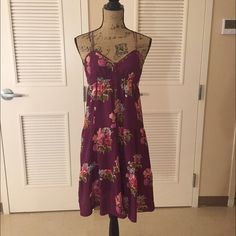 AEO Strappy Floral Dress American Eagle size 6 floral purple dress. So cute for spring!!! Has really cool strap details and also has buttons down the front for an added flair. Would fit 4-6 or typical size small. Love this with some sandals and a floppy hat :) make an offer or bundle to save! American Eagle Outfitters Dresses