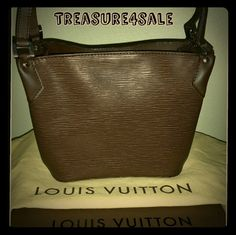 """Louis Vuitton Mandara PM in Epi Moka M5893D Authentic Louis Vuitton Mandara PM Epi Moka, beautiful chocolate brown with darker undertones and silver tone hardware. Shoulder strap drop 9/10/11"""". Includes dust bag, box, LV tags. EUC some minor scuffs in a few spots relating to the leather handle strap and leather details as shown in photos. Do not find any noticeable scuffs or flaws on epi leather. Interior is clean with no stains or other signs of wear. NO Trades NO PP Offer through Posh…"""