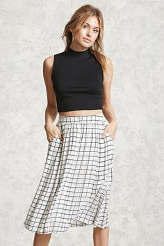 Forever 21 Contemporary - A woven skirt featuring an allover grid print, button front, slanted front pockets, a flared hem, and a partially elasticized waist.