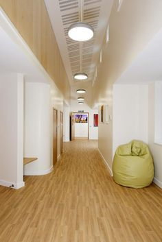 Breakout spaces, with built-in seating and curved walls. Oakwood Home For Adults Wtih Autism at Oakland's Hospital near Caterham, Surrey, England. Photo: © Edward Hopley 2014