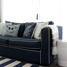 Good morning l just love this navy sofa with white trim from a room tour with @michele_judd you can see more on DIY Decorator.
