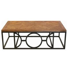 Circle Parquet French Contemporary Wood Coffee Table by Kathy Kuo Home. $1563.00. Metal base has black finish. Metal base features open circular design. 19 inches high x 60 inches wide x 33 inches deep. Constructed from parquet wood and metal. Features curved parquet design tabletop. Update the look of your living room with a modern twist on the traditional coffee table. The rustic, reclaimed wood of inlaid parquet creates a beautiful yet practical surface, ready...