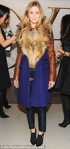 Fashion Front Row @ #NYFW Fall 2014 | Olivia Palermo in a Diane von Furstenberg blue & brown coat with a fur collar & leather sleeves, Tibi metallic blue cropped pants & Rebecca Minkoff  black ankle booties