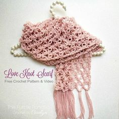 The Love Knot Scarf is very lacy and delicate looking. The way it is constructed it makes a loopy, knotted design resembling diamond shapes. This Free Crochet Pattern includes Crochet Video for stitch placement and Photo Tutorial. Get it at www.thepurpleponcho.com #crochetbycarolyn #loveknot #solomonsknot #crochetscarf