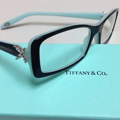 New for 2013 - Tiffany & Co. Eyeglasses and Sunglasses. This is TF 2043-B. color 8055 top black/blue