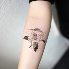 camellia flower #camelliaflower #flowertattoo #triangletattoo #blacktattoo…