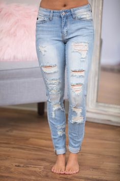 These beautiful light wash skinny jeans are a must-have for spring! Featuring a trendy distressed look all over the front legs and around the belt loops, it's an edgy way to add a pop of style to your