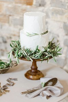 white cake with olive leaf garland