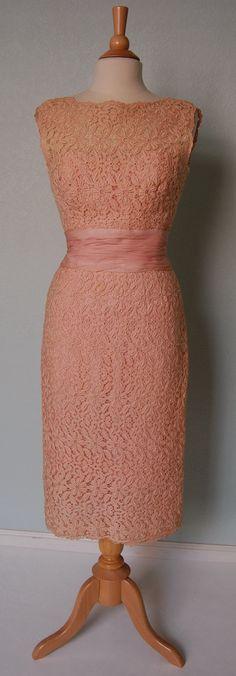 1950s fashion: pink peach salmon lace coloured pencil or wiggle dress.