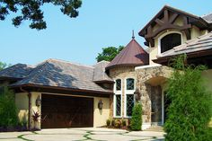 French Cottage custom home design in Florida, by Design Styles Architecture.