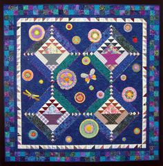 Enchanted Baskets quilt by Jean Brueggenjohann.  SAQA featured artist.