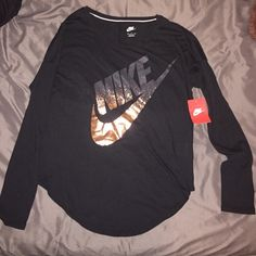 Long sleeve Nike shirt! It's absolutely brand new still has tags, I got it as a gift last Christmas and have never worn it. It's a women's size Medium. Make me an offer! :) Nike Tops Tees - Long Sleeve