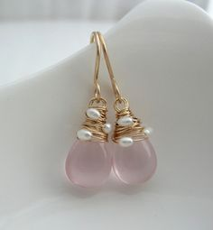 Stunning flawless pale pink Rose Quartz broilettes are hand wrapped with tiny fresh water pearls.