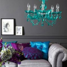 gray wall and turquoise chandelier // maybe not my taste in colors or textures but definitely a great idea to make a little bright color go a long way.