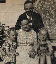 """Heinrich Himmler with his daughter Gudrun, wife Margaret, and adopted son.  Himmler doted on Gudrun, who was the epitome of the """"Aryan"""" archetype. She even visited Dachau with him, commenting that, """"...We saw everything we could...We saw all the pictures painted by the prisoners...it was very nice."""" She had no idea (then) that her father had selected millions of people for Sonderbehandlung (special treatment), an SS euphemism for gassing. Gudrun, 83, and still a fervent Nazi, lives in…"""