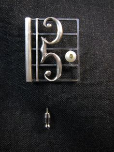 This Sterling C clef brooch was crafted for Marie Mielbrecht, who has spent a lifetime mastering the Bassoon.
