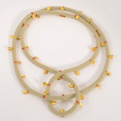 """Claire Kahn at Patina Gallery. Necklace, White Miyuki Beads with 18k Gold Petals and Coral Beads, 42"""" long, .5"""" diameter"""