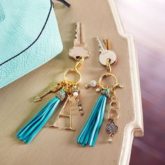 Craft a trendy tassel keychain personalized with charms and beading.