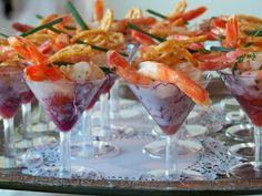 individual shrimp cocktails served in martini glasses