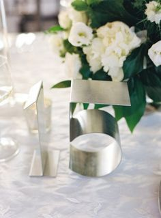 Standing stainless steel numbers. Photography by charlottejenkslewis.com Event Planning by 6degreesofcelebration.com/index2.php Floral Design by hatchcreativestudio.com  Read more - http://www.stylemepretty.com/2013/06/17/bronx-wedding-from-charlotte-jenks-lewis-hatch-creative-studio/