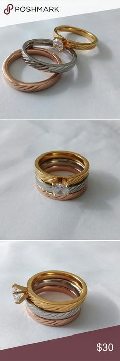 New 3-Piece Ring Set New Stainless Steel 3-Piece Ring set.  All three rings are size 7.  Very beautiful rings that can be worn together or separately.  They will last a long time.  One band has a small white cubic zirconia. Jewelry Rings