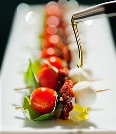 Great ideas for appetizers, presentations - here, cherry tomato, basil, sundried tomato, mozzerella.