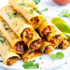 Baked Chicken Taquitos recipe is an easy and healthy appetizer to serve for a Cinco de Mayo party! Pre-cooked shredded chicken gets mixed together with diced onion, chunky salsa, refried black beans, and cheddar cheese for a quick Mexican food recipe. Mexican Food Recipes, Yummy Recipes, Cooking Recipes, Healthy Recipes, Ethnic Food Recipes, Party Food Recipes, Healthy Food, Yummy Food, Easy Baked Chicken