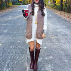 Layer a fur vest over a sweater dress