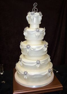 gorgeous wedding cake with brooch accents!!