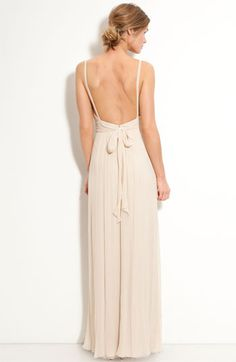 an outdoor wedding would call for a dress-back like this one. - MAC